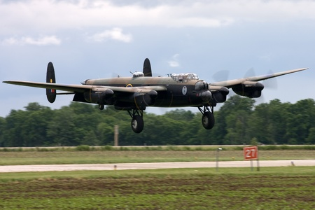 St. Thomas, Canada - June 25, 2011: A World War II British Avro Lancaster bomber comes in for a landing at the Great Lakes International Air Show.