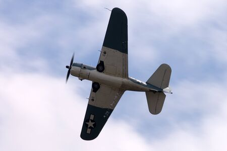 curtis: St. Thomas, Canada - June 25, 2011: A Curtis SB2C Helldiver, World War II dive bomber flies past at the Great Lakes International Air Show.