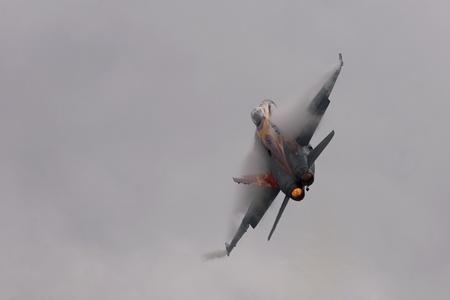 St. Thomas, Canada - June 25, 2011: A CF-18 Hornet makes a high speed turn at the Great Lakes International Air Show.