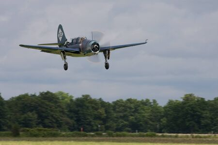 curtis: St. Thomas, Canada - June 25, 2011: A Curtis SB2C Helldiver, World War II dive bomber lands at the Great Lakes International Air Show. Editorial