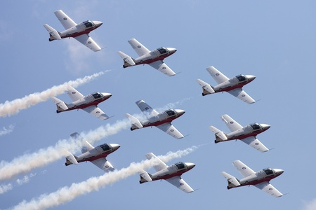 St. Thomas, Canada - June 25, 2011. The Canadian Forces 431 Air Demonstration Squadron Snowbirds perform at the Great Lakes International Air Show.