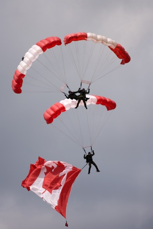 canadian military: June 26, 2011. St. Thomas Ontario Canada. Members of the Canadian Forces parachute team the Skyhawks make their way to the ground during an exhibition at the Great Lakes International Air Show in St. Thomas Ontario.