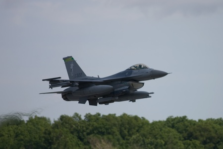 f 16: June 26, 2011. St. Thomas Ontario Canada. A F16 Fighting Falcon from the 158th  Fighter Wing of the Vermont Air National Guard in mid air flight at the Great Lakes International Air Show in St. Thomas Ontario.