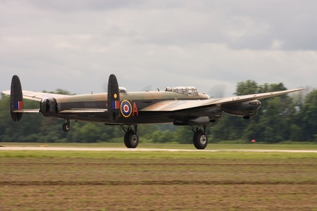St. Thomas, Canada. June 25, 2011. A World War II Avro Lancaster touches down at the Great Lakes International Air Show.