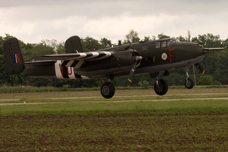 St. Thomas, Canada. June 26, 2011. A Mitchell B-25 World War II bomber touches down at the Great Lakes International Air Show.
