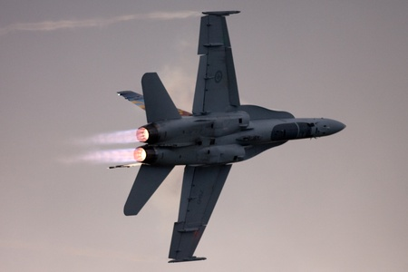 St. Thomas, Canada. June 24, 2011: A Canadian Forces CF-18 makes a highspeed afterburner turn at the Great Lakes International Air Show.