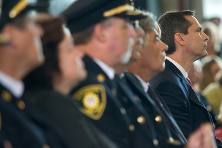 honouring: London, Canada - September 11, 2011: On the 10th anniversary of the attacks on the United States, the London Ontario Fire Department unveiled a monument honouring the 21 London Firefighters who lost their lives while on the job. Dalton McGuinty, right, Pr Editorial