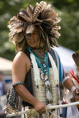 London, Canada - September 17, 2011: A First Nations Canadian wearing traditional clothing participates in a Pow Wow dance during the annual Native Harvest Festival and Pow Wow at the Attawandaron Village located in the Museum of Ontario Archaeology in Lo Stock Photo - 10781491