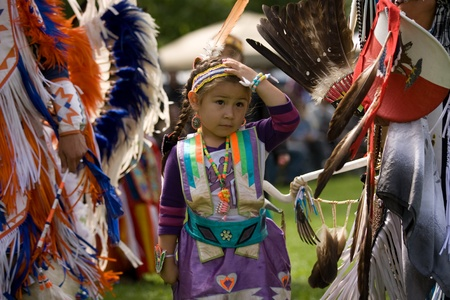 traditional: London, Canada - September 17, 2011: A First Nations Canadian wearing traditional clothing participates in a Pow Wow dance during the annual Native Harvest Festival and Pow Wow at the Attawandaron Village located in the Museum of Ontario Archaeology in Lo