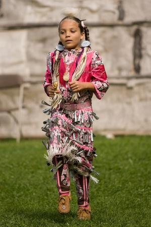 pow wow: London, Canada - September 17, 2011: A First Nations Canadian wearing traditional clothing participates in a Pow Wow dance during the annual Native Harvest Festival and Pow Wow at the Attawandaron Village located in the Museum of Ontario Archaeology in Lo