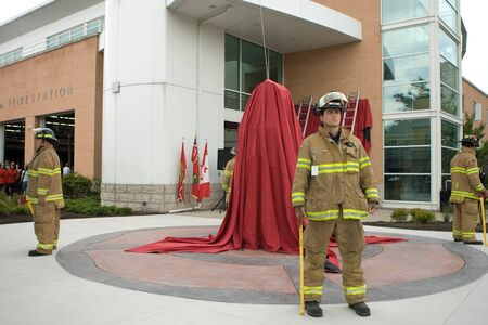 honouring: London, Canada - September 11, 2011: On the 10th anniversary of the attacks on the United States, the London Ontario Fire Department unveiled a monument honouring the 21 London Firefighters who lost their lives while on the job. An honour guard of four fi