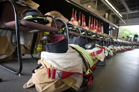 honouring: London, Canada - September 11, 2011: On the 10th anniversary of the attacks on the United States, the London Ontario Fire Department unveiled a monument honouring the 21 London Firefighters who lost their lives while on the job. 21 sets of coats, boots an Editorial