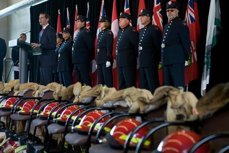 London, Canada - September 11, 2011: On the 10th anniversary of the attacks on the United States, the London Ontario Fire Department unveiled a monument honouring the 21 London Firefighters who lost their lives while on the job. Ontario Premier Dalton McG Editöryel