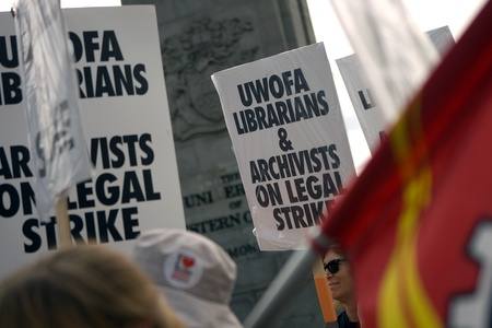 librarians: London, Canada - September 14, 2011: Members of the University of Western Ontario Faculty Association - Librarians and Archivists picket at the Richmond Street gates of the University of Western Ontario in London. One of the main issues in the strike is t Editorial