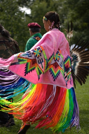 London, Canada - September 17, 2011: A First Nations Canadian wearing traditional clothing participates in a Pow Wow dance during the annual Native Harvest Festival and Pow Wow at the Attawandaron Village located in the Museum of Ontario Archaeology in Lo Stock Photo - 10781564