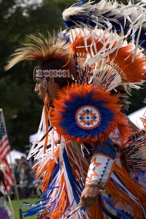 London, Canada - September 17, 2011: A First Nations Canadian wearing traditional clothing participates in a Pow Wow dance during the annual Native Harvest Festival and Pow Wow at the Attawandaron Village located in the Museum of Ontario Archaeology in Lo