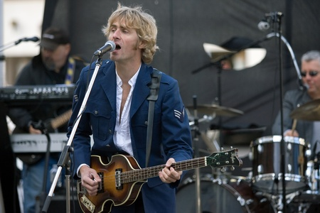 London, Canada - September 14, 2011: Yuri Pool and his tribute band The McCartney Years played a free concert over the lunch hour in downtown London. The band has played other free public events the most notable being a re-creation of the famous Beatles