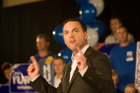 conservative: London, Canada - September 12, 2011: Tim Hudak, leader for the Progressive Conservative Party of Ontario speaks to party faithful at a rally in London Ontario. Hudak stressed the need for change after eight years of Liberal rule under Dalton McGuinty.