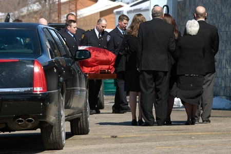 converged: March 24, 2011. Listowel, Ontario. The flag drapped casket of Ken Rae is carried into the Listowel Community Arena for a private funeral service. Thousands of firefighters from Ontario, Quebec and the United States converged on Listowel to honour voluntee