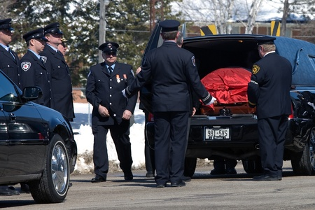 converged: March 24, 2011. Listowel, Ontario.  The casket of volunteer firefigher Raymond Walter arrives at the Listowel Memorial Arena. Thousands of firefighters from Ontario, Quebec and the United States converged on Listowel to honour volunteer firefighters Ken R