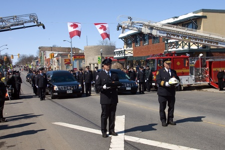 converged: March 24, 2011. Listowel, Ontario. Thousands of firefighters from Ontario, Quebec and the United States converged on Listowel to honour volunteer firefighters Ken Rae 56 and Raymond Walter 30. The two died while battling a fire on March 17, 2011.  Editorial
