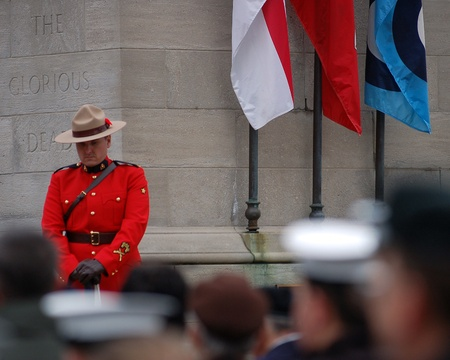 London, Ontario, Canada. November 11, 2008. A Royal Canadian Mounted Police officer, also known as a Mountie, stands a post during Remembrance Day services.