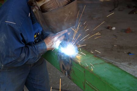 welds: May, 2006.  Parkhill, Ontario, Canada.  A farmer welds a patch onto a guide of his planter.