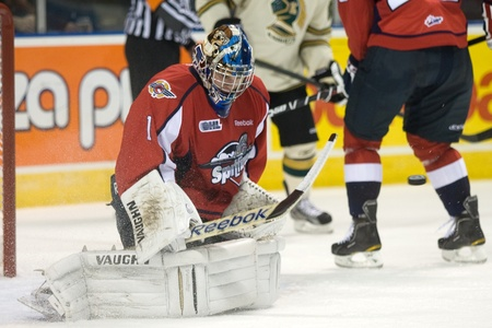 john labatt centre: London Ontario, Canada - October 7, 2011. Windsor Spitfire goalie and draft pick of the Dallas Stars, Jack Campbell makes a stop against the London Knights. Windsor won the game 5-2.  Editorial