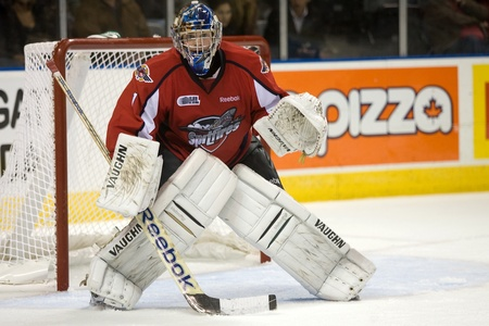 London Ontario, Canada - October 7, 2011. Wiindsor Spitfire goalie and a draft pick of the Dallas Stars of the National Hockey League Jack Campbell watches the action from his crease during Windsors 5 - 2 win over London.