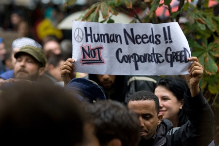 Toronto Ontario, Canada - October 15, 2011. The Occupy Wall Street movement emerged in a number of Canadian cities on Saturday. In Toronto a crowd that grew to 3000 gathered at King and Bay then marched and occupied St. James Park.  Editorial