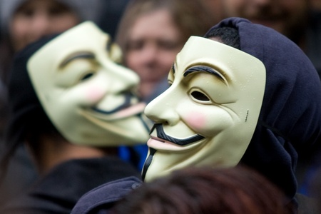 Toronto Ontario, Canada - October 15, 2011. The Occupy Wall Street movement emerged in a number of Canadian cities on Saturday. In Toronto a crowd that grew to 3000 gathered at King and Bay then marched and occupied St. James Park. These masks could ultim