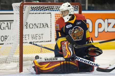 john labatt centre: London Ontario, Canada - October 14, 2011. Erie Otter goalie Tyson Teichmann watches the puck as it slips past him and goes just wide of the net in a game against the London Knights. London won the game 6-4.