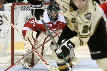 john labatt centre: London Ontario, Canada - October 9, 2011. Soo Greyhound goalie Micheal Nishi watches the action from his crease during a game versus the London Knights. London won the game 4-1.