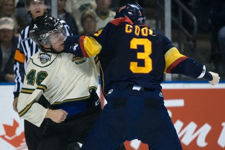 London Ontario, Canada - October 14, 2011. Matt Rupert of the London Knights, left, dukes it out with Brett Cook of the Erie Otters. London won the game 6-4.  Stock Photo - 10911435
