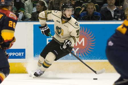 chris: London Ontario, Canada - October 14, 2011. Chris Tierney of the London Knights crosses the blueline the stops to look to make a pass. London won the game 6-4.