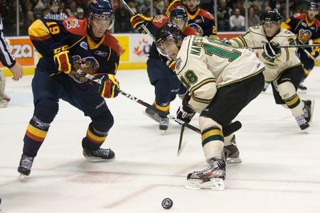 olden: London Ontario, Canada - October 14, 2011. Vladislav Namestnikov of the London Knights, right, wins a faceoff against Sondre Olden of the Erie Otters. London won the game 6-4.  Editorial