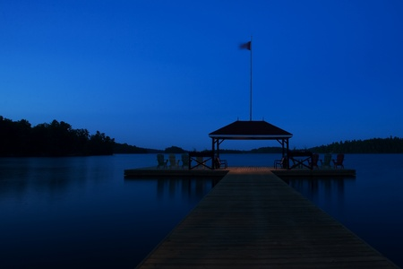 Port Severn Ontario, Canada - June 1, 2011. The dock at Severn Lodge, Muskoka Ontario bathed in the blue of pre-dawn light.
