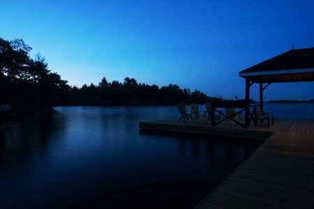 Port Severn Ontario, Canada - June 1, 2011.The dock at Severn Lodge in Muskoka Ontario just before sunrise.