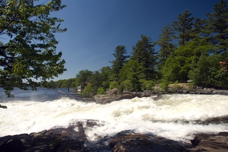 muskoka: Bala, Canada - June 2, 2011: The fast moving Bala Falls located in the Muskoka region of Ontario Canada.