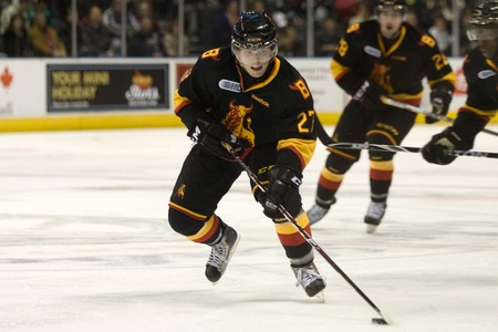 London Ontario, Canada - October 21, 2011. Dylan Corson (27) of the Belleville Bulls carries the puck in a game against the London Knights. London won the game 4-0.  Editorial