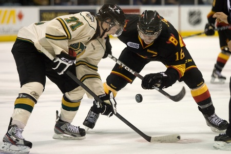 chris: London Ontario, Canada - October 21, 2011. Chris Tierney (71) of the London Knights battles with Brendan Gaunce (16) of the Belleville Bulls. London won the game 4-0. Editorial