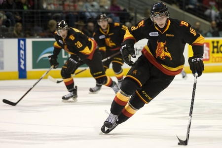London Ontario, Canada - October 21, 2011. Adam Payeri of the Belleville Bulls carries the puck during a game against the London Knights. London won the game 4-0.