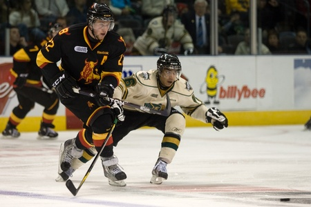 john labatt centre: London Ontario, Canada - October 23, 2011. Andreas Athanasiou (86) of the London Knights poke checks the puck away from the Belleville Bulls Brady Austin (22) in their game. London won the game 4-0.   Editorial