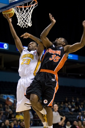 london lightning: London Ontario, Canada - Tim Ellis (23) of the London Lightning goes up for a basket against Antwi Atuahene (33) of the Oshawa Power during their National Basketball League of Canada game. London won the game 111-83. Editorial
