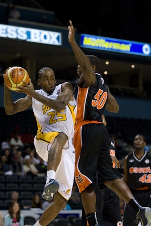 london lightning: London Ontario, Canada - October 23, 2011. Gabe Freeman of the London Lightning (25) goes up for basket against Jushay Rocket (50) of the Oshawa Power during their National Basketball League of Canada game. London won the game 111-83.