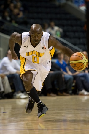 london lightning: London Ontario, Canada - October 23, 2011. DeAnthony Bowden (0) of the London Lightning carries the ball up the court in a National Basketball League of Canada game against the Oshawa Power. London won the game 111-83.