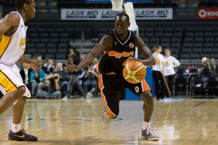 london lightning: London Ontario, Canada - October 23, 2011. Tut Ruach of the Oshawa Power carries the ball up the court in a National Basketball League of Canada game against the London Lightning. London won the game 111-83.