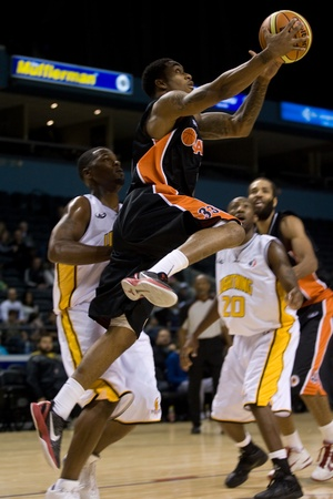 London Ontario, Canada - October 23, 2011. Jahaziel Howard of the Oshawa Power goes up for a basket during a National Basketball League of Canada game against the London Lightning. London won the game 111-83.  Editorial