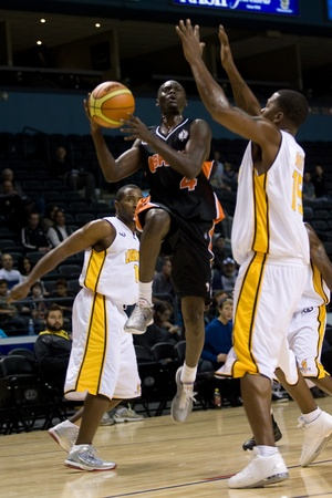 john labatt centre: London Ontario, Canada - October 23, 2011. Tut Ruach (4) of the Oshawa Power splits the defence and goes up for basket in a National Basketball League of Canada game against the London Lightning. London won the game 111-83.