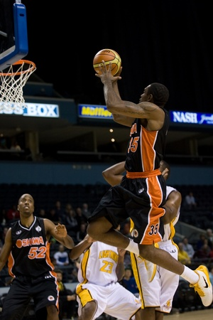 john labatt centre: London Ontario, Canada - October 23, 2011. Akeem Wright of the Oshawa Power goes up for a basket in a National Basketball League of Canada game against the London Lightning. London won the game 111-83.